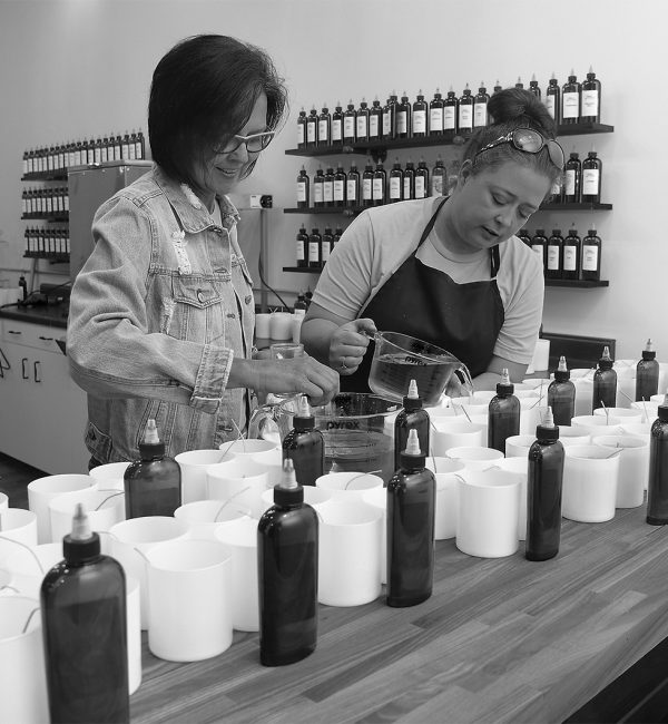 Julie Smith/News Tribune In addition to her downtown shop Unique Creations, Lisa Kindle, at left, will now offer the opportunity for the public to stop in to make their own candles. The store is Unique Candles and customers can have the choice to purchase ready-made scented candles or make their own. The scent bar contains over 80 scent choices. Wednesday saw Kindle and Jennifer Martin, at right, along with Heather Gray and wax and scent company representative Jake Schaffner making candles to have for sale when the store opened Friday.  In addition to her downtown shop Unique Creations, Lisa Kindle will now offer the public to stop in to make their own candles. The store is Unique Candles and customers can have the choice to purchase ready-made scented candles or make their own. There are over 80 scent choices from which to choose.  Pictured are owner Lisa Kindle, Heather Gray, Jennifer Martin and Jake Schaffner.